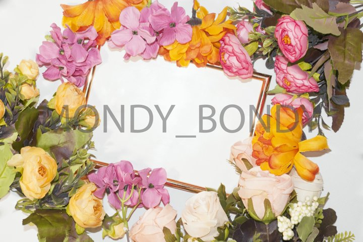 Flat lay.Golden photo frame and bouquet of flowers