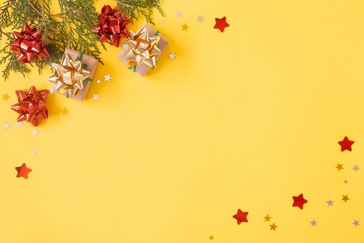 Christmas flat lay background. Gift boxes with glitters