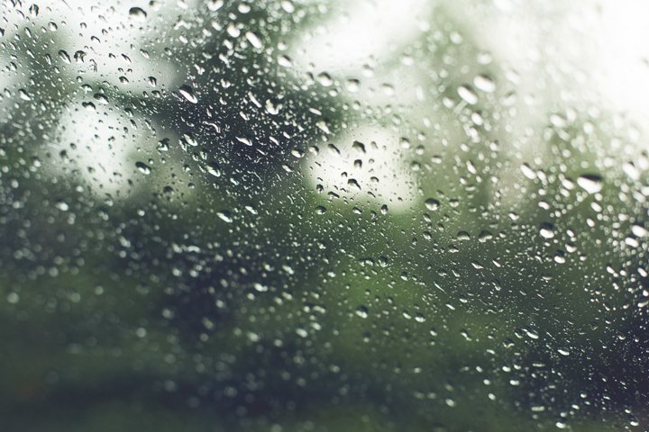 Water drops on the window pane after a spring rain