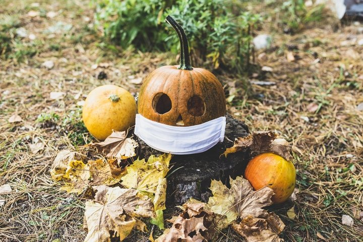 halloween pumpkin in protective mask, holiday concept virus