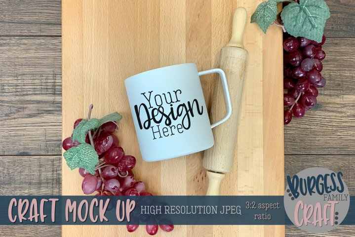 White mug on cutting board with grapes | Craft mock up