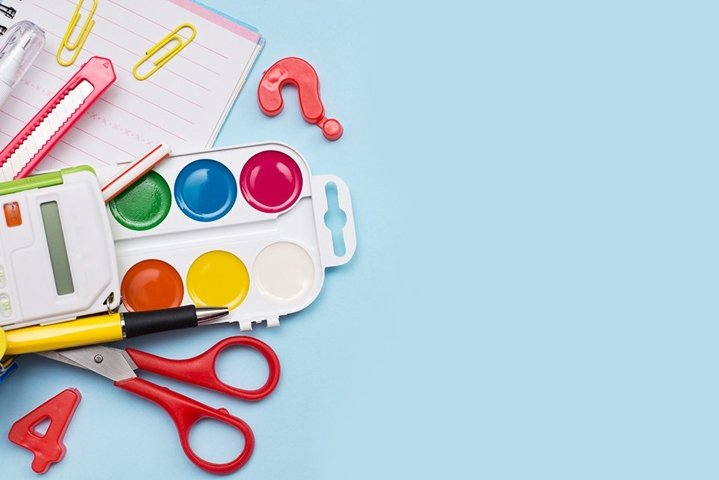 Colorful school stationery on blue background