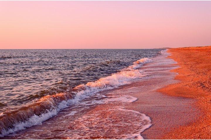 Coastline. Seascape on summer morning, pink sunrise