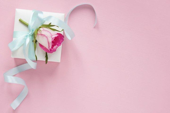 Gift box and rose flat lay.
