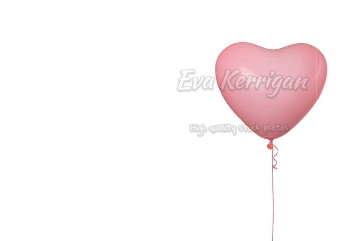 Pink bright air rubber balloon in shape of heart isolated.