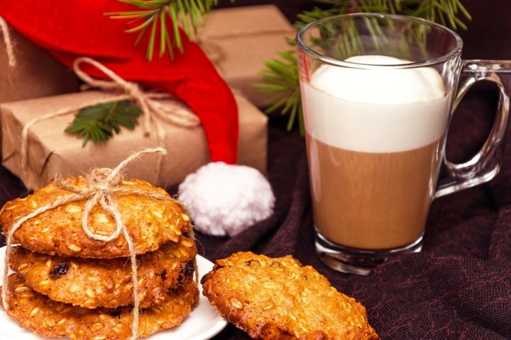 Christmas crispy oatmeal cookies, mug of coffee, gift boxes