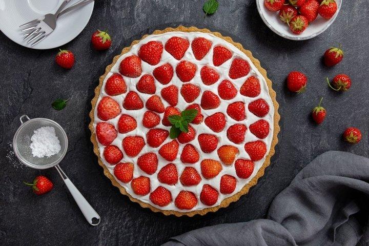 Photo of strawberry tart with cream cheese. Flat lay.
