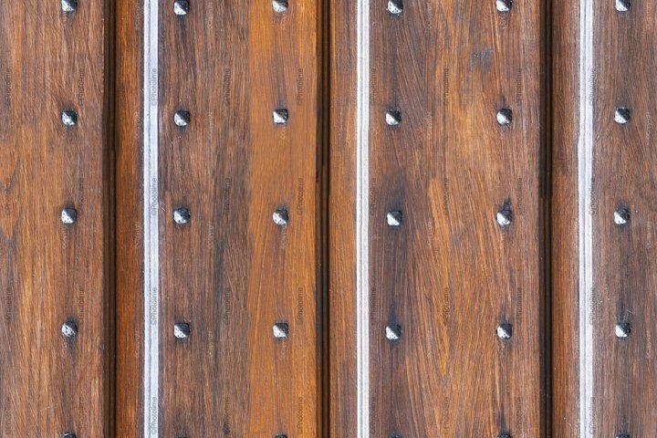 Door of italian ancient medieval building texture