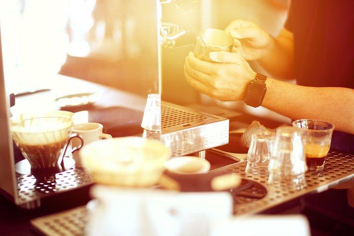 close up barista making cappuccino with Espresso machine