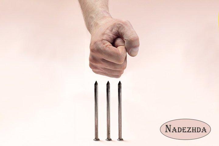 Human fist against sharp nails