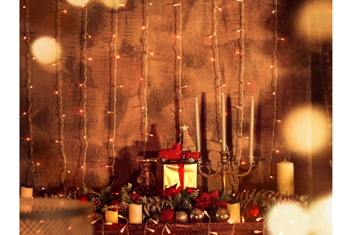 Fireplace with party supplies, candles, gifts, lights