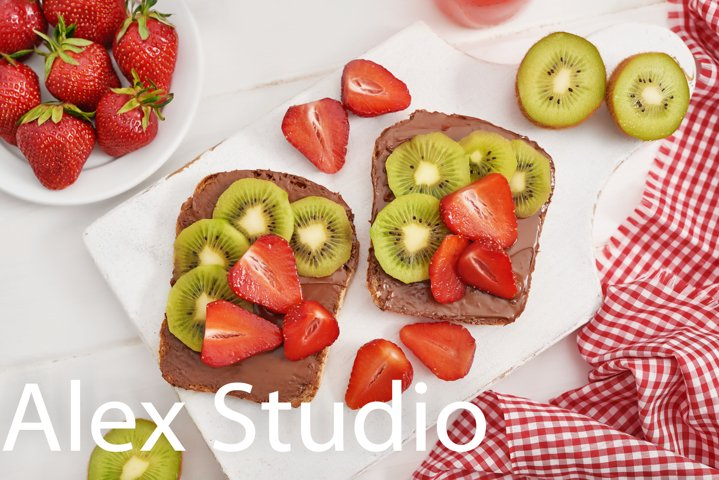 Fruit Sandwich, strawberries and kiwi. Peanut Butter Toast.