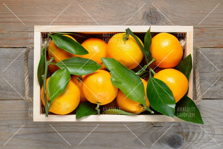 Mandarins in wooden box top view