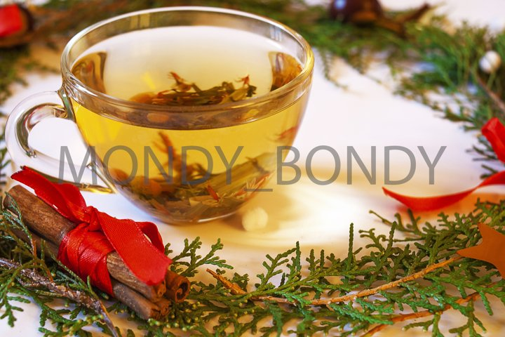 A cup of herbal winter tea and New Years decor