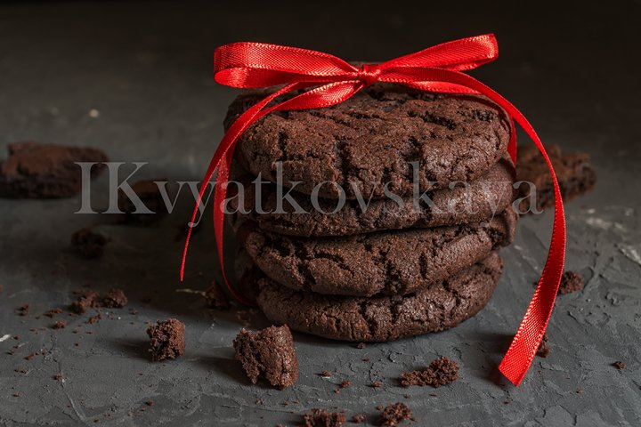 stuck of chocolate brownie cookies with red ribbon
