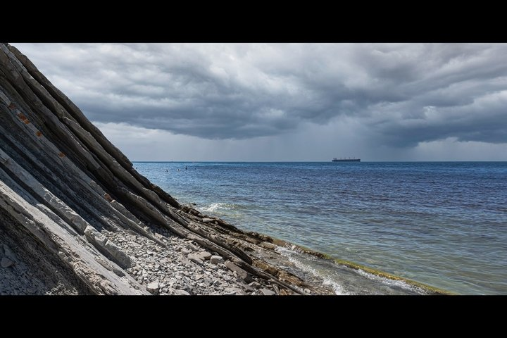 Panorama of the seascape. Picturesque stone wild beach. 2pcs