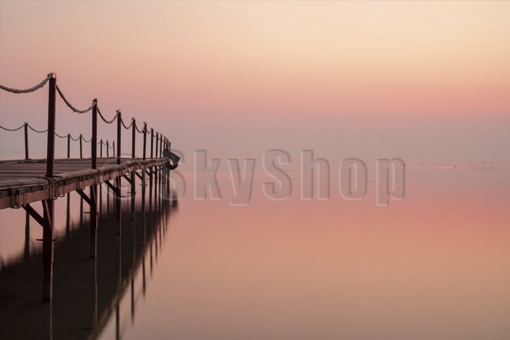 Early morning on the lake in summer. old pier