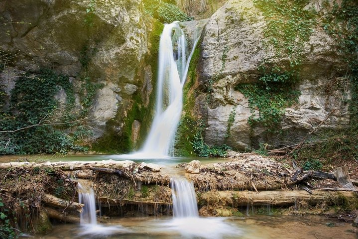 Beautiful waterfall in the forest. Water motion