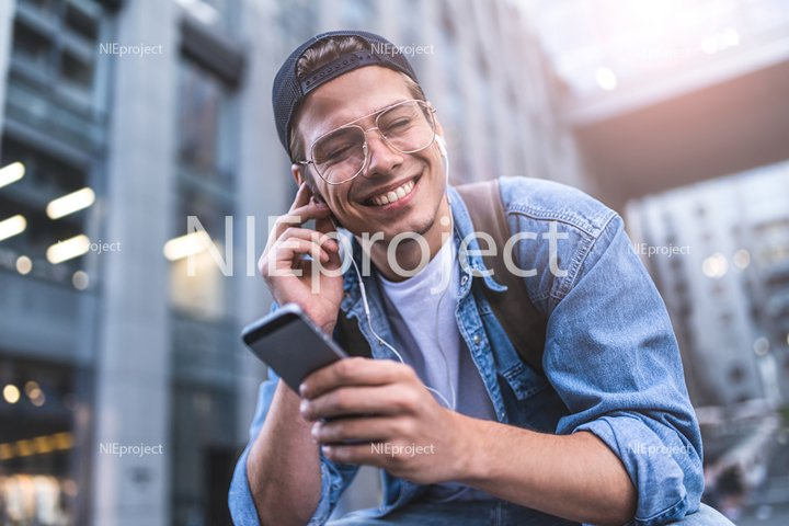 Happy man listening to music with headphones