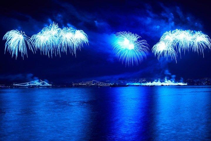 Blue colorful fireworks on black sky background