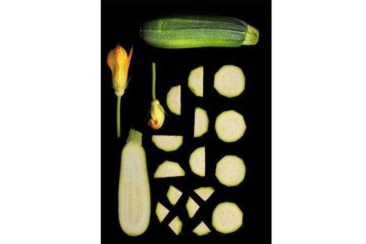 Set of green zucchini on black background