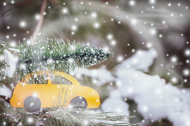 Stylish wooden car with a Christmas tree