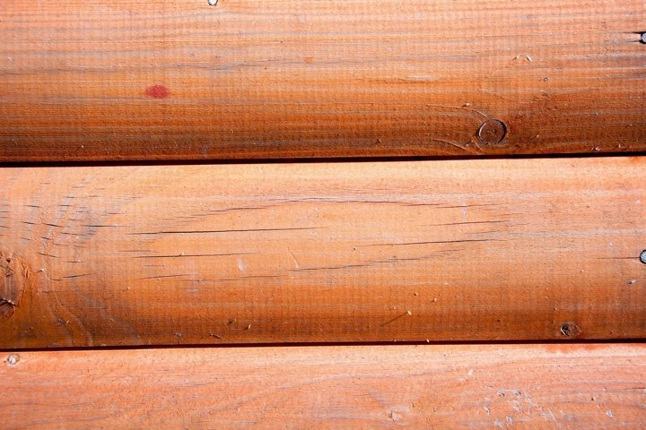 Brown wood plank wall texture background. Close up macro.