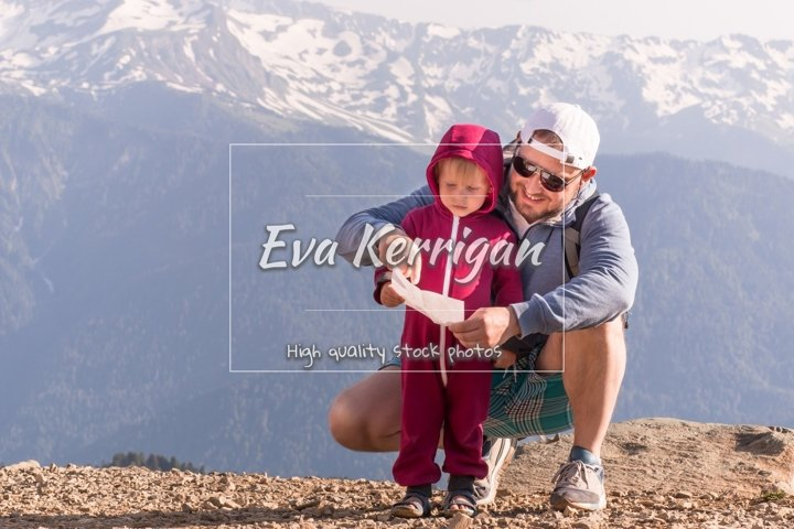 Happy father and son on the top of a mountain in Rosa Khutor