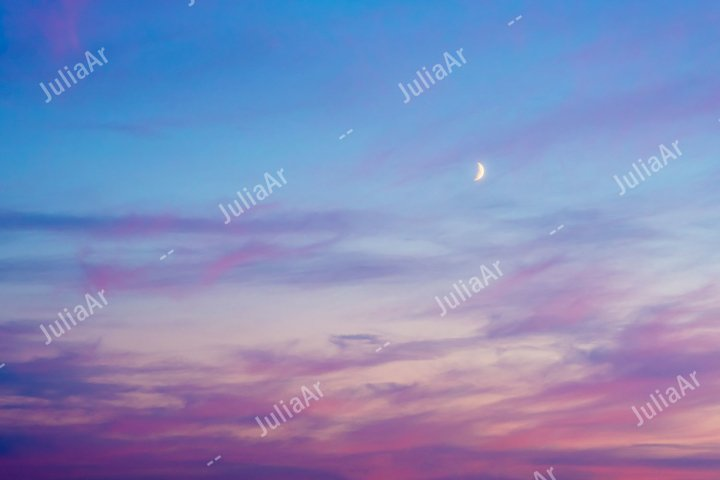 Red sunset sky with crescent moon