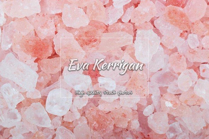 Grains of crystals of pink Himalayan salt, closeup shot.