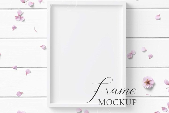 5x7 White Frame Mockup on white wood background.