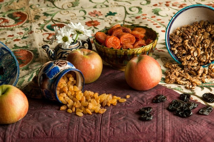 Still life in oriental style, dried fruits and tablecloth