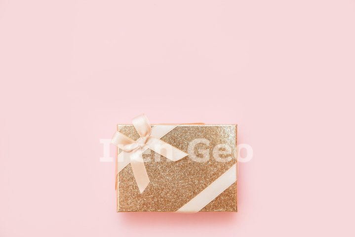 Flat lay of romantic gift decorated with ribbon