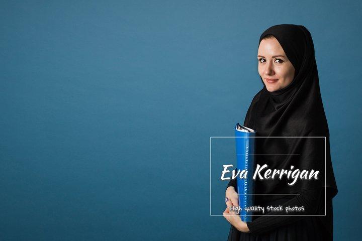 Beautiful Muslim girl secretary or office manager in hijab.