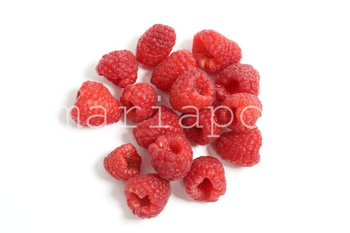 Fresh Harvest Organic Raspberries Isolated on White