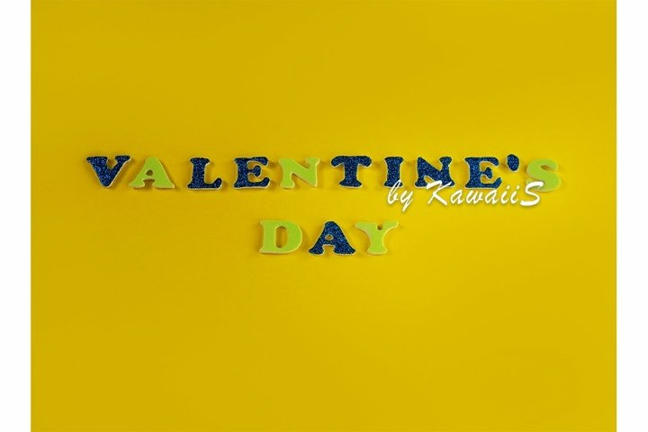 Valentines Day Love glitter sign text on yellow background