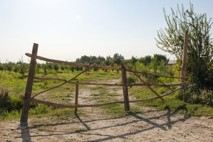Old abandoned wooden fence on the farm