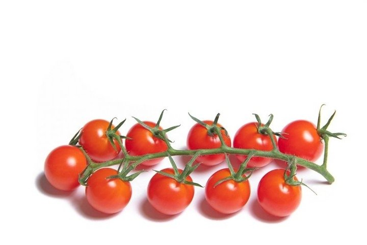 Cherry tomatoes branch isolated on white background
