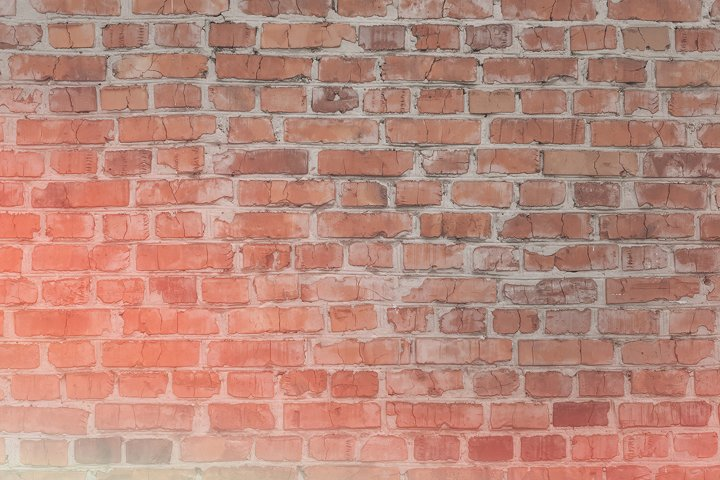 Old cracked red brick wall