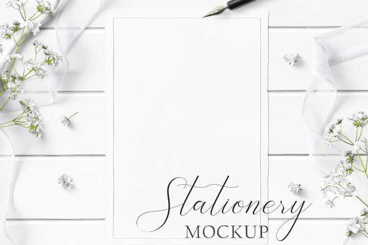 5x7 Stationery Mockup with textured paper on white wood.
