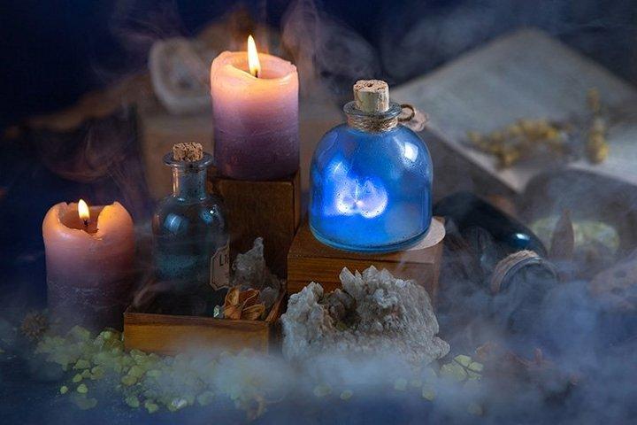 Night fabulous still life.Lab wizard.Flasks, candles, magic.