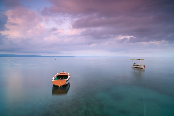Two boats in adriatic sea at sunrise