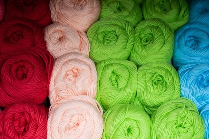 Skeins of thread in red, pink, green and blue