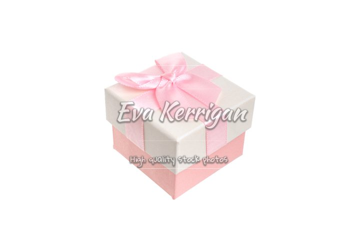 Beige gift box with a delicate pink engagement bow. Present.