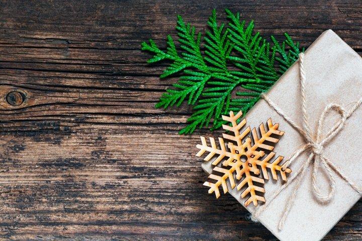 Christmas background. Gift box, snowflake, green fir branch