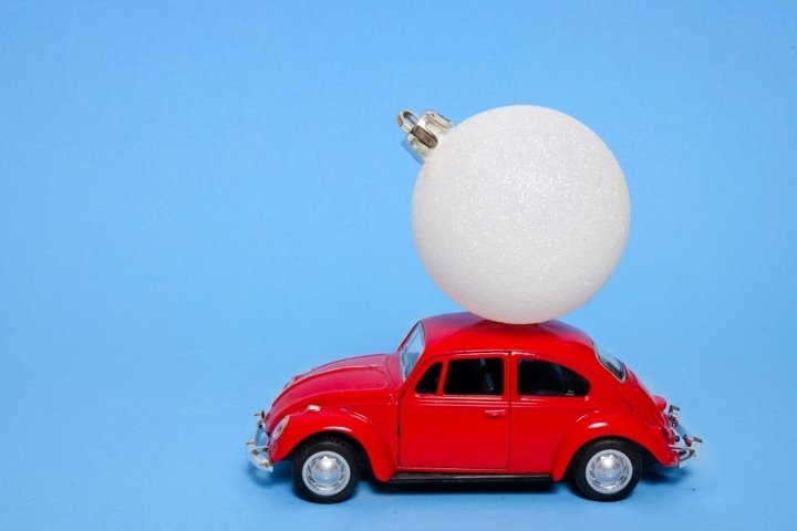red toy car and snow ball on the roof