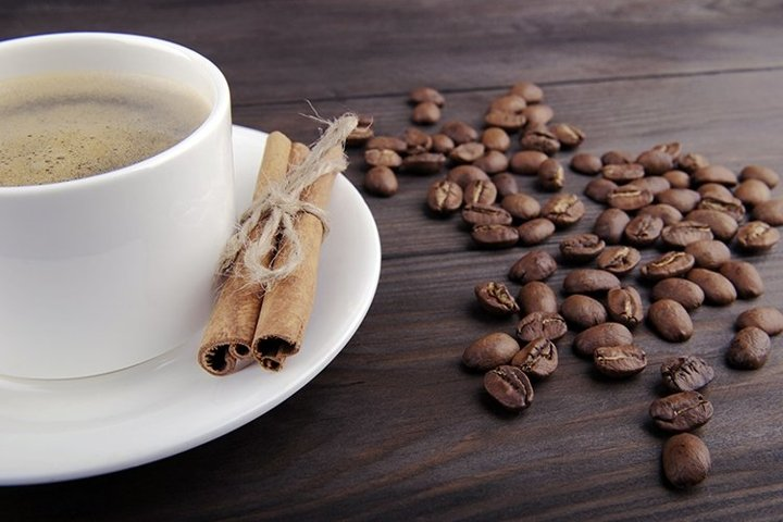 Coffee cup, cinnamon and beans