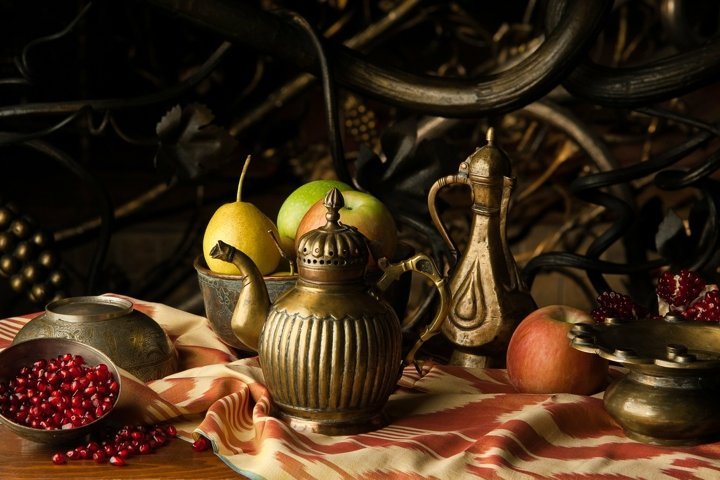 Still life in oriental style made of fruit and jugs
