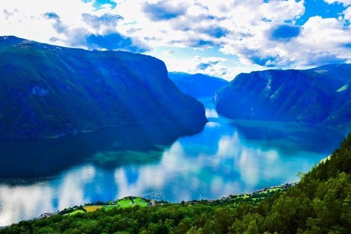 Sunbeams over fjord. Norway.