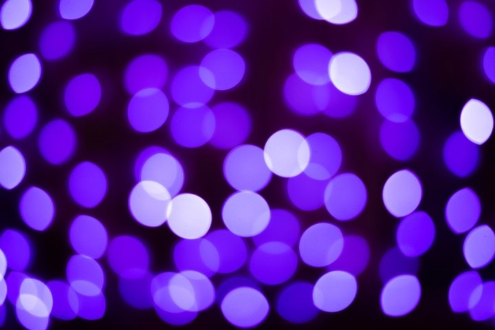 Defocused abstract purple bokeh lights christmas background